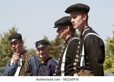 STAPHORST, NETHERLANDS – AUGUST 5, 2015. Group unknown men in costume.
