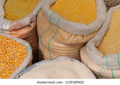 Staple food rice and corn in sacks. / Rice and corn in sacks