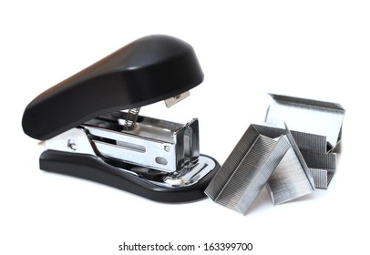 a lot of staple and stapler on white background