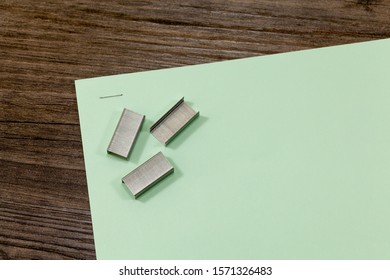 Stapled piece of paper with blocks of staples