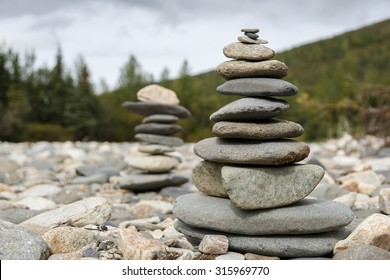 Stapled stones Rocks Stacked Close Up in a river bed