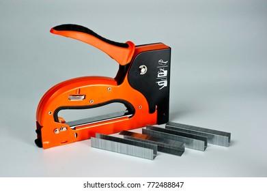 Stapler household, new, orange, reliable with staples