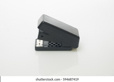 A stapler over white background