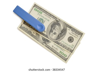 Stapler with stack of dollars isolated on white background