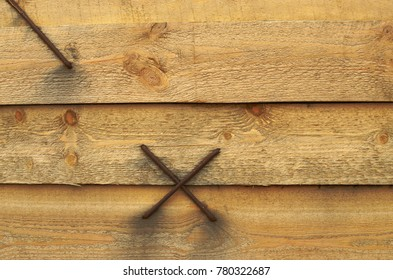 Staples hammered into the wooden beams.The boards form a single array.