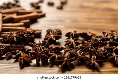 Star anise and cinnamon. Aromatic spices on wooden background. Top view. Close up. Seasoning ingredients for cooking or baking