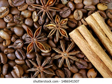star anise, cinnamon, and roasted coffee beans. roasted coffee and spices. top view