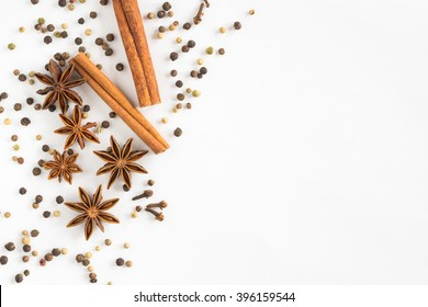 Star anise, cinnamon sticks, cloves and pepper on a white background
