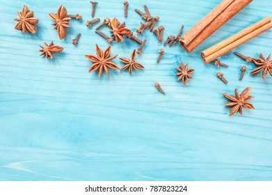 Star anise, cinnamon sticks and cloves on a nintage background. Selective focus.