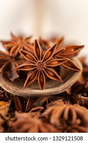 star anise closeup on a wooden spoon