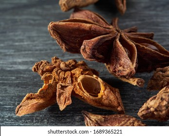 Star anise is lying on a gray wooden table