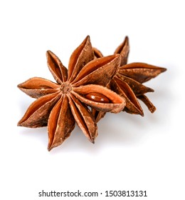 Star anise spice. Two dry star anise fruits isolated on white background with shadow. Macro close-up top view of illicium verum or chinese badiane.