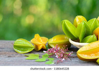 Star apple fruit, Organic Fresh Star fruit or Carambola (Averrhoa carambola) on wooden table concept for herbal plant
