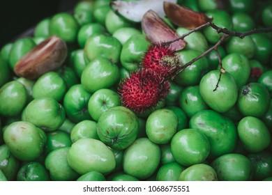 Star apples, rambutan and dragin fruit in a market