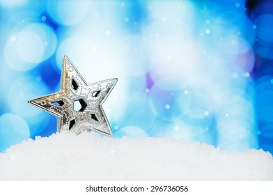 Star and christmas decoration on abstract background and snowflakes,  selective focus shot