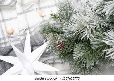 Star and Christmas tree on plaid background