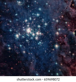Star cluster Trumpler 14. One of the largest gatherings of hot, massive and bright stars in the Milky Way galaxy. Retouched colored image. Elements of this image furnished by NASA.