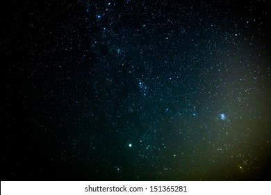 A star cluster within a faint nebula... a birthplace of stars