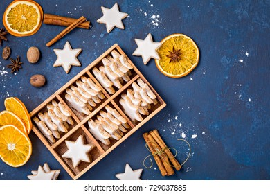 Star Cookies in a gift box with spices and dried oranges over a blue background.  Christmas or Yom Kippur.
