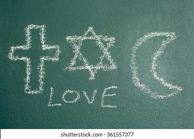 Star of David, Cross and Islamic Crescent on a blackboard.