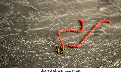 Star of David on red thread, selective focus