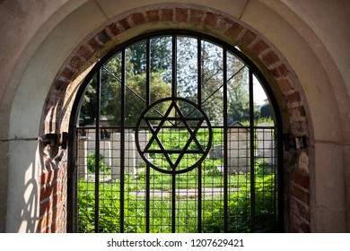 Star of David symbol on arched window grating at old cemetery in Jewish Quarter of Kazimierz in Krakow, Poland