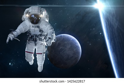 Star eclipse. Exoplanets and astronaut in deep space. Science fiction. Elements of this image furnished by NASA
