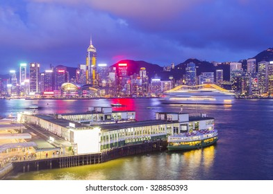 Star Ferry Pier at Tsim Sha Tsui with skyline of Hong Kong in the background at twilight