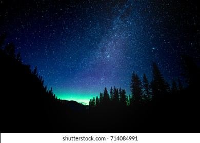 Star gazing the Milky Way with Northern Lights at Lake Moraine in Banff National Park