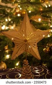 Star on decorated lit Christmas Tree