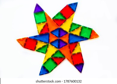 Star pattern made with magnet tiles on white background.