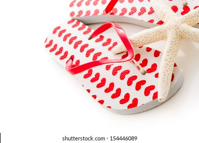 Star sea shell with flip flops on a white background.