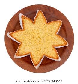Star shape slice of pandoro, Italian sweet yeast bread, traditional Christmas treat. Overhead flat lay view. Isolated on white.