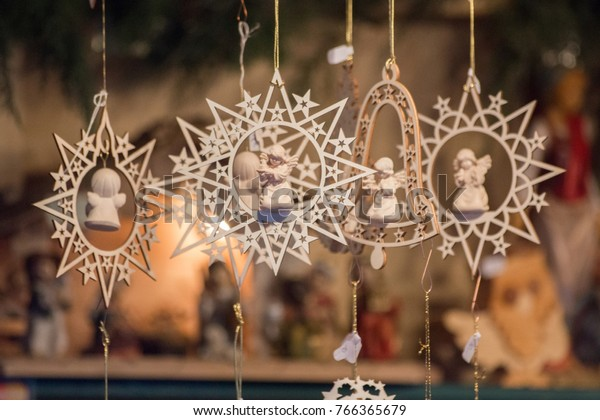 Star shaped and bell shaped wooden Christmas ornaments with small angels