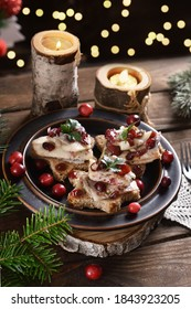 star shaped canapes with herrings in oil and dried cranberries for Christmas