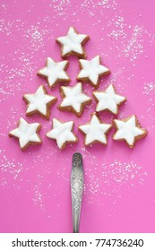 star shaped cinnamon cookies on pink background