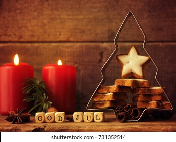 Star shaped cinnamon cookies in a tree shaped baking tin, Christmas concept background, Scandinavian Merry Christmas
