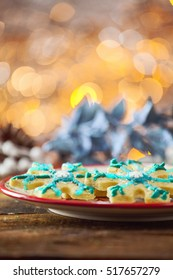 Star Shaped Gluten Free Organic Christmas Sugar Cookie On Festive Holiday Plate And Warm Glowing Vertical Background.