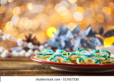 Star Shaped Gluten Free Organic Christmas Sugar Cookie On Festive Holiday Plate And Warm Glowing Background.