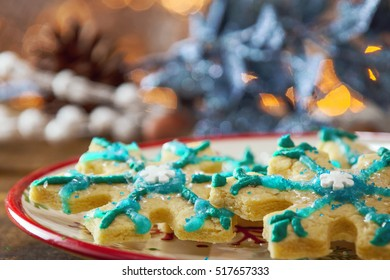 Star Shaped Gluten Free Organic Christmas Sugar Cookie Close Up On Festive Holiday Plate And Warm Glowing Background.