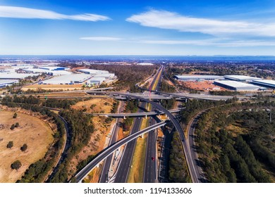 Star shaped Light HOrse intercharge intersection of Motorways M4 and M7 in Sydney West seen from above over multi lane highway.