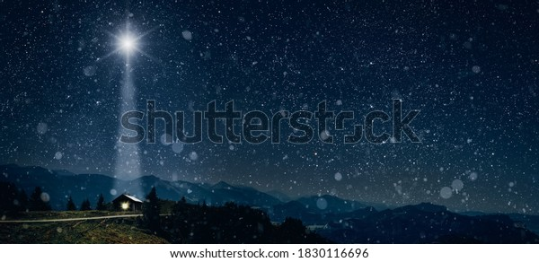 The star shines over the manger of christmas of Jesus Christ.