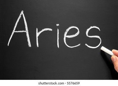 The star sign Aries written on a blackboard.