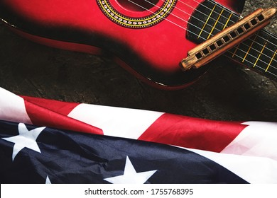 Star spangled banner, guitar and harmonica. Musical instrument and flag of the United States of America