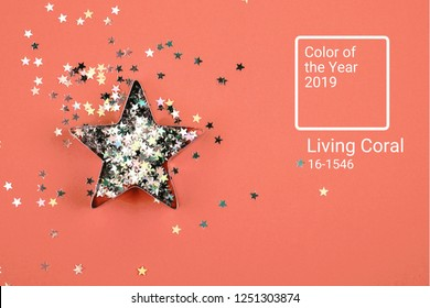 Star with sparkles and shape for gingerbread on Living Coral background. Color of the year 2019 concept.