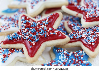 Star sugar cookies decorated for 4th of July Independence day celebration in America. Icing and sprinkles in red, white, and blue. selective focus. Very little depth of field.