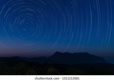 Star trail above Doi Luang mountain seen from Doi Ma Taman camping site, Chiang Mai, Thailand