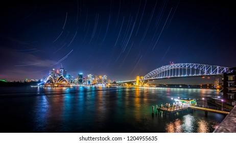 Star trail above night sky at Sydney city