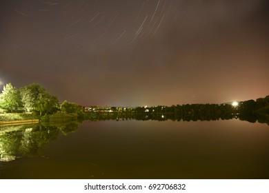Star trail over a beautiful lake near sterling city USA