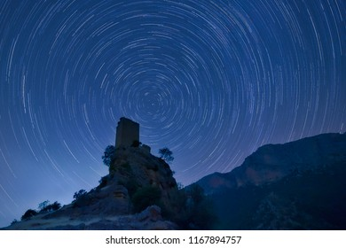 Star trail over Piñar´s Castle in Jaen, Andalusia, Spain, night photography